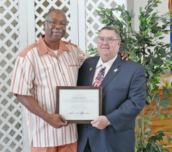Carver Young receives the Spirit of Bartow Award from another 2014 winner, Dr. Thomas McMicken.